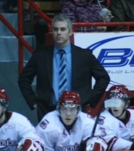 Dominique Ducharme on the bench as assistant coach of the Montreal Juniors of the Quebec Major Junior Hockey League